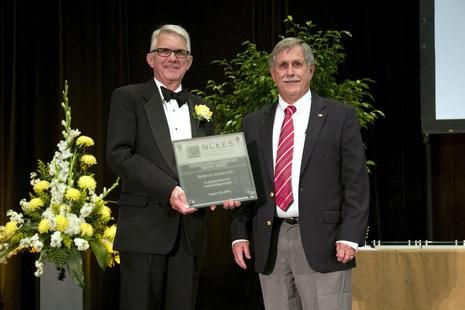 Past President John Steadman accepted the award on behalf of Richard Schwarz.